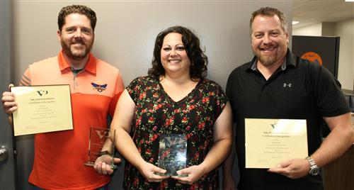 Scott Rausch, Krissy Martin, and Brad Spawr pose with awards